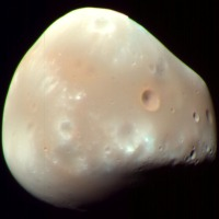 Deimos, Mars smaller moon.
